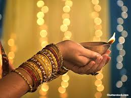 hands holding light